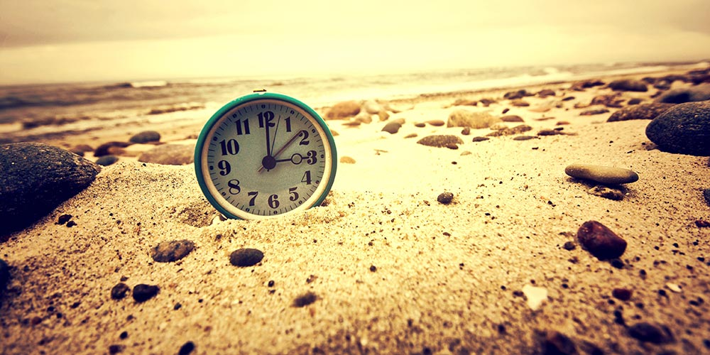 Clock on the beach. Time and business concept.